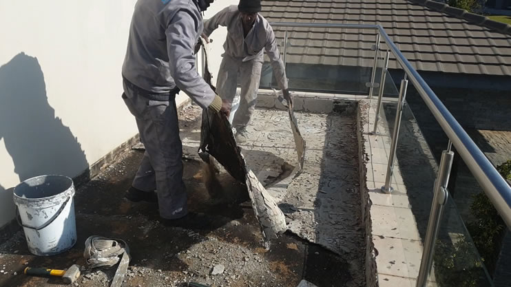 How can I waterproof a concrete slab roof terrace so that it will never leak