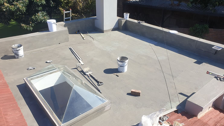 What is the first layer for waterproofing of concrete roof slab?